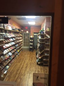 This is another picture taken inside the humidor showing the shelves of cigars along both sides.