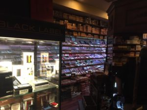 This is inside the humidor at Smoke On The Water. Cigars in boxes are piled to the ceiling