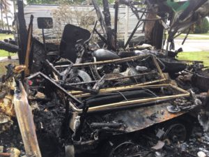 Picture of our trailer burnt to the ground with my motorcycle inside
