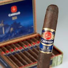 Pic of an E P Carrillo Dusk and an open box of them