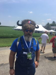 pic of guy wearing fur hat with horns at Barn Smoker