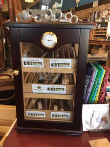 Pic of the small humidor with Cattle Baron cigars inside of Atomic 79