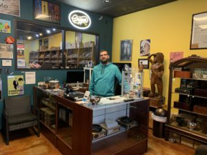 A pic of Gabe behind the counter as I enter Cigar Pointe