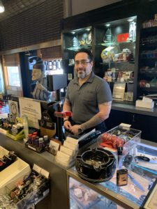 pic of Joe Torres behind the counter