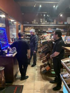 Pic of Crux customers in humidor
