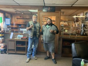 Dustin and Me in front of the Humidor at Seguin cigars