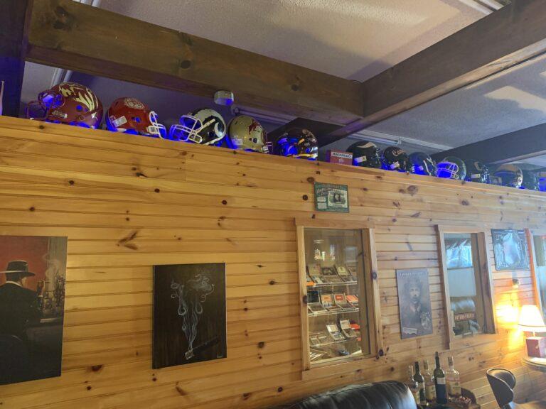 pic of football helmets above humidor