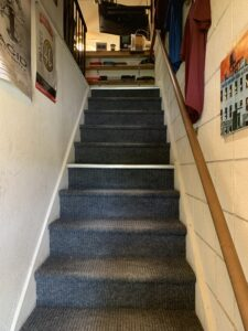 Stairs up to the shop